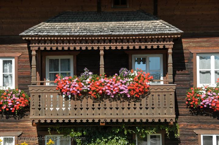 a balcony with geraniums
