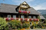 Pictures of Austria - Countryside - Mountains - traditional wooden house, geraniums