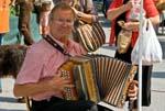 man playing an accordeon, market day