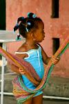 little girl playing with a hammock