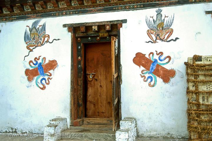 Pictures of Bhutan - Paro - phallus symbols to ward off evil spirits