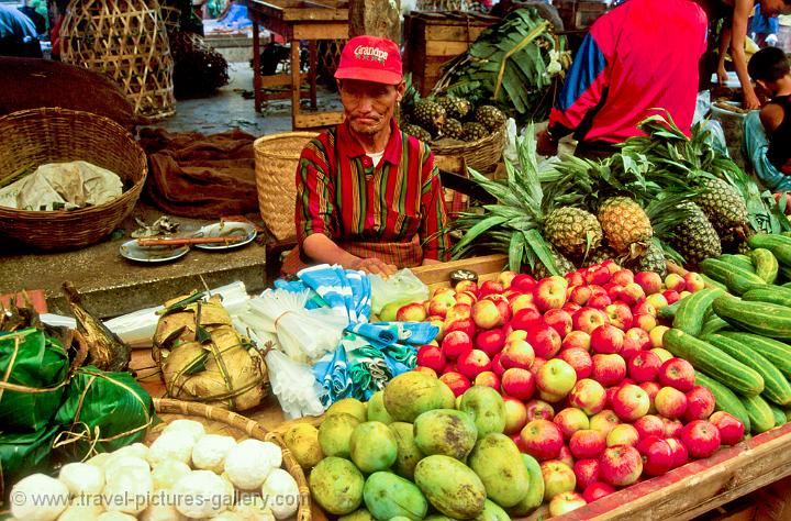 Pictures of bhutan thimphu man selling fruit and vegetables at the