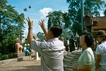 releasing birds for good fortune at Wat Phnom