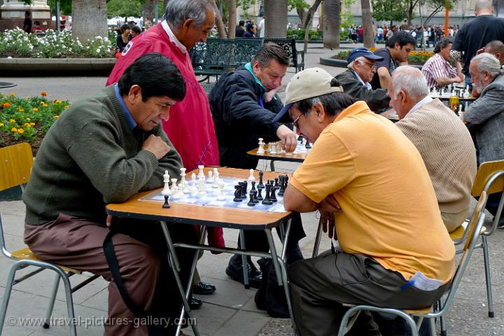 people playing chess on the Plaza de Armas
