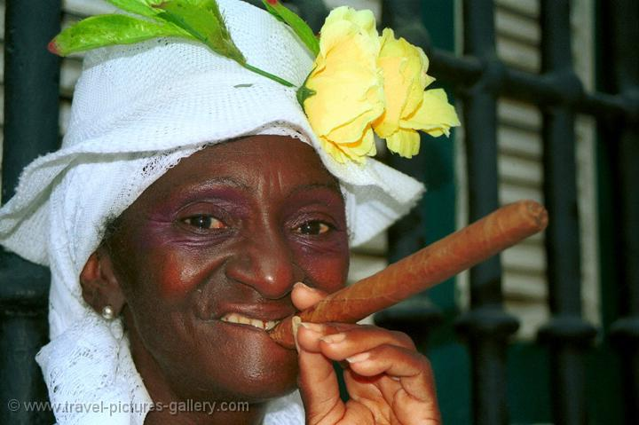 Pictures of Cuba - woman in traditional clothing with a cigar, Havana
