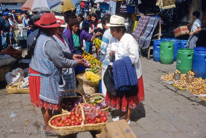 women in traditional indigenous dress at the market