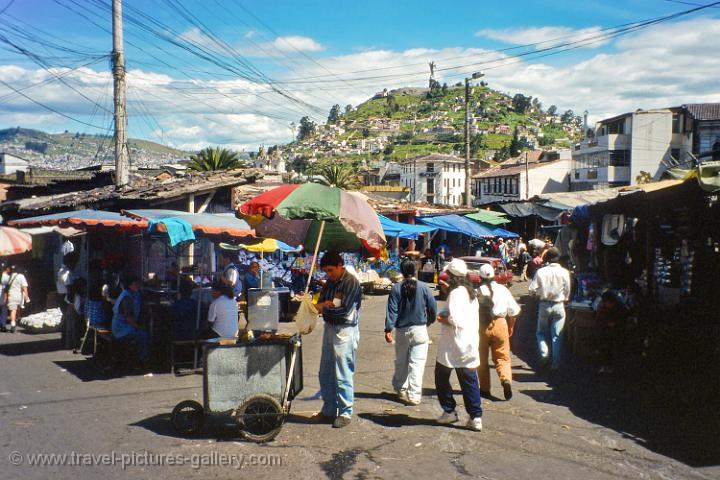 local market with Panecillo hill