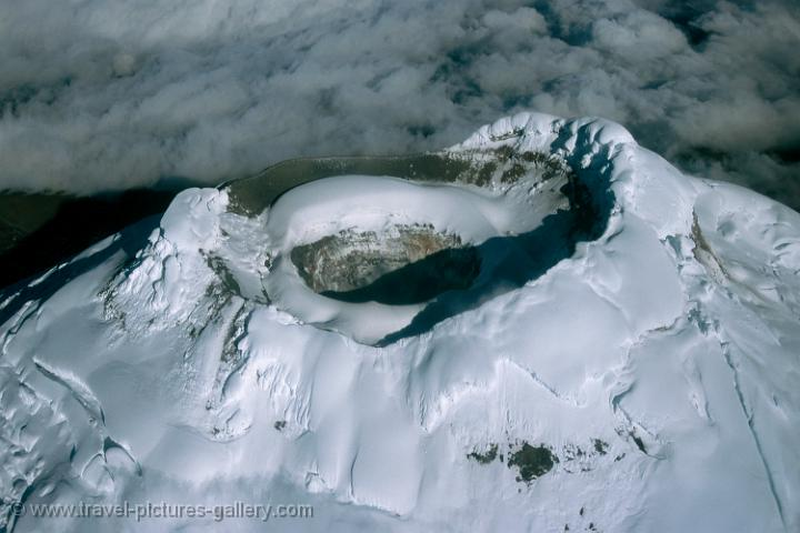 snow-capped Cotopaxi volcano crater from the air (5,897 m)