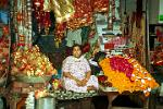 lady selling temple offerings, Haridwar