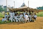 a cricket team having tea at the Maidan