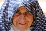 Pictures of Iran - Kharanaq - friendly old woman with headscarve