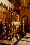 pilgrims and altar at the Church of the Holy Sepulchre