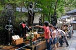 kids pooring water over statues, mausoleum of Kobo Daishi