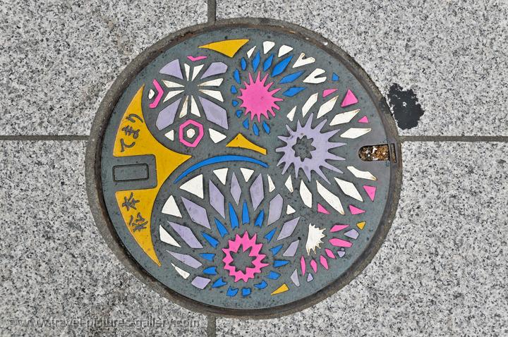 a decorated pothole cover