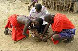 Masai men making a fire, Samburu N.P.