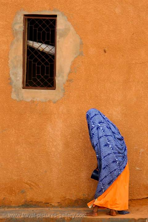Pictures of mauritania 0011 ochre wall and colourful dress Wall pictures