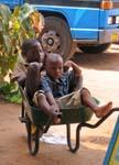 boys lazing in a wheelbarrow, Morongulo