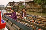 women trading from their canoe, Ywama floating market