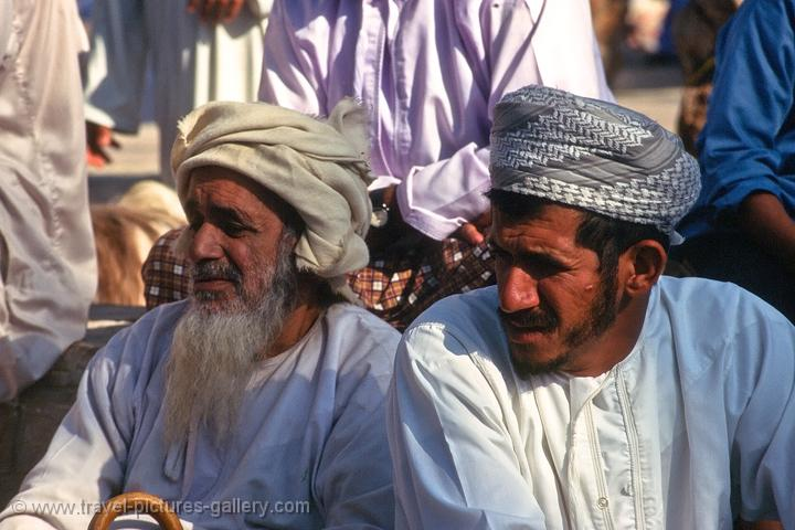men in traditional dress, at Nizwa market