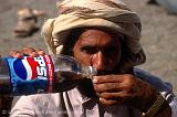 Pictures of Oman - man having a drink