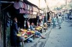 street stalls selling hats and fruit in Gilgit