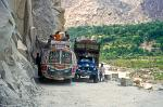 bus and truck passing at the narrow road to Chitral