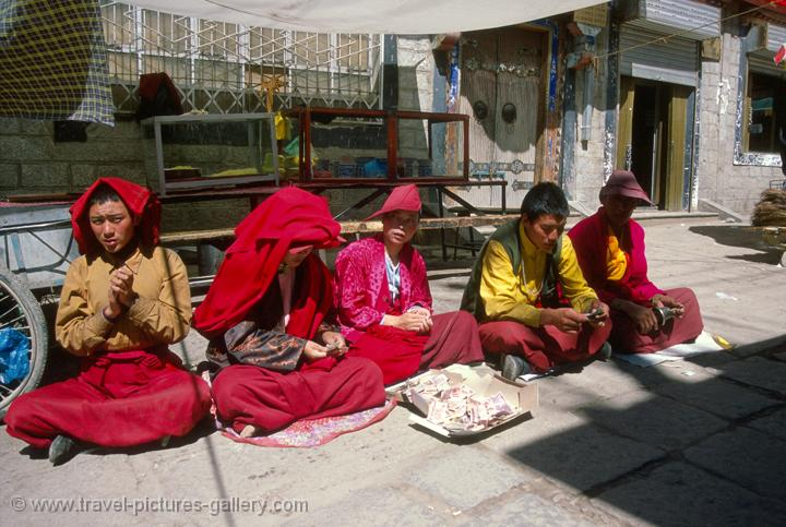 monks chanting on Barkhor Circuit (a clockwise circle around the Jokhang)