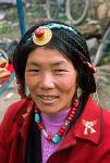 a woman wearing traditional Tibetan jewelry
