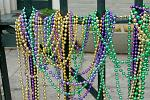 beads hanging on a fence