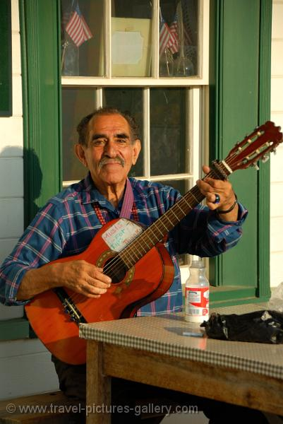 California - San Diego, elderly man playing guitar