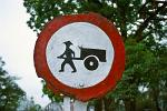 traffic sign, man with straw hat and cart crossing